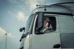 A Truck Driver Sitting in the Cab of a Truck